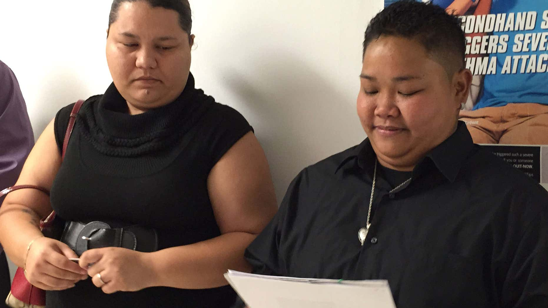 April 8, 2015: Loretta M. Pangelinan, 28, right, holds the application for a marriage license that she and her fiancee, Kathleen M. Aguero, 28, will turn in at the Office of Vital Statistics in the Guam Department of Public Health and Social Services.