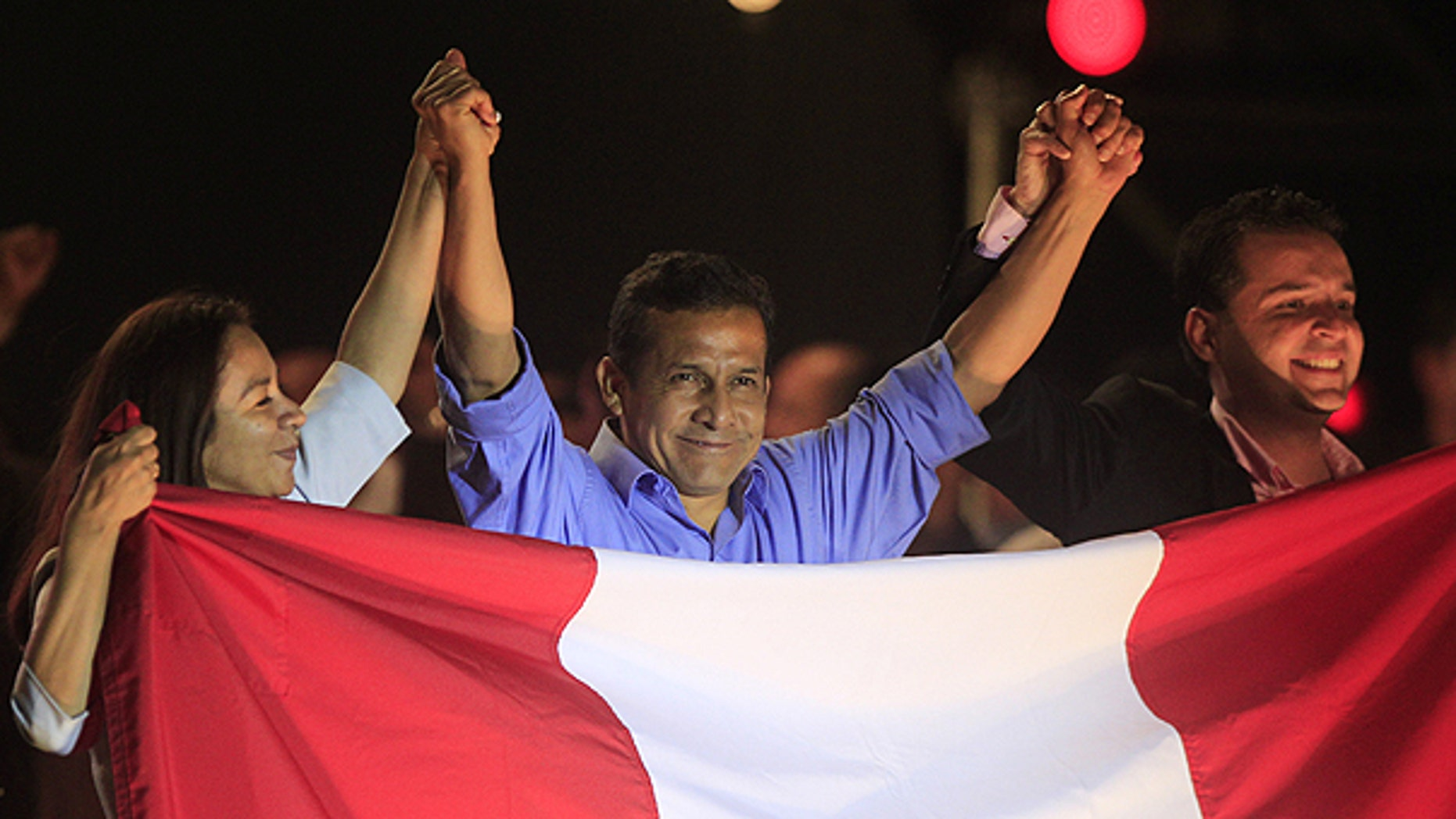 June 5: Peru's presidential candidate Ollanta Humala, center, raises hands with his running mates First Vice President Marisol Espinoza, left, and Second Vice President Omar Chehade after the presidential runoff election in Lima, Peru.