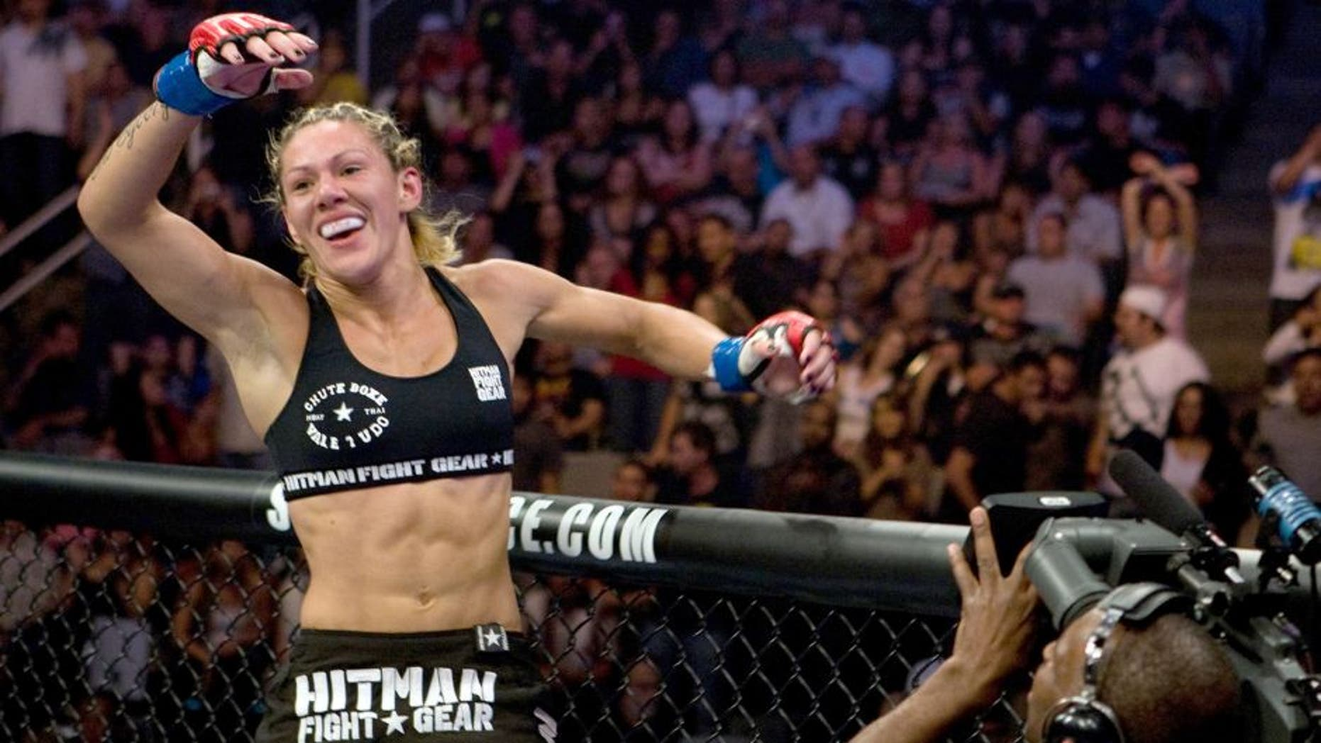 SAN JOSE, CA - AUGUST 15: Cristiane 'Cyborg' Santos celebrates after her victory over Gina Carano during the inaugural Strikeforce Women's Championship event at HP Pavilion on August 15, 2009 in San Jose, California. (Photo by Esther Lin/Forza LLC/Forza LLC via Getty Images) *** Local Caption *** Cristiane Santos; Gina Carano