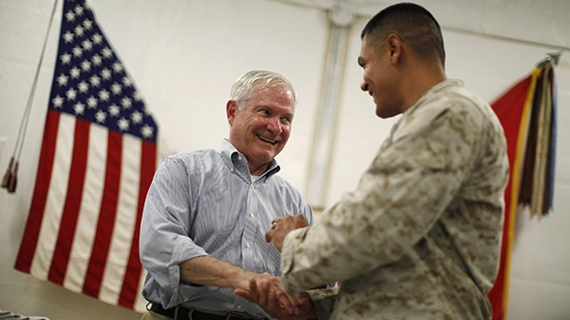 June 5: U.S. Secretary of Defense Robert Gates, left, talks with a U.S. Marine at Forward Operating Base (FOB) Dwyer, Afghanistan.