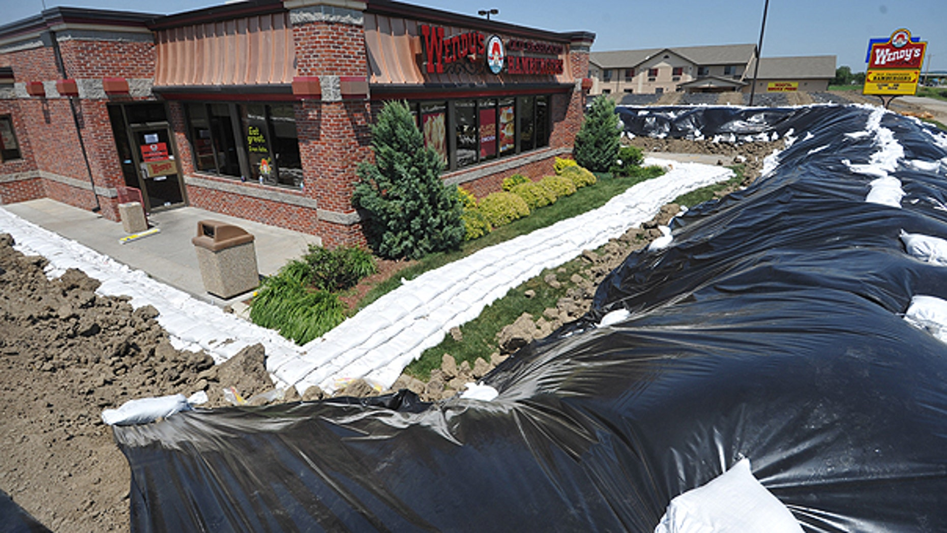 June 6: A Wendy's restaurant is surrounded by a temporary berm in Hamburg, Iowa.