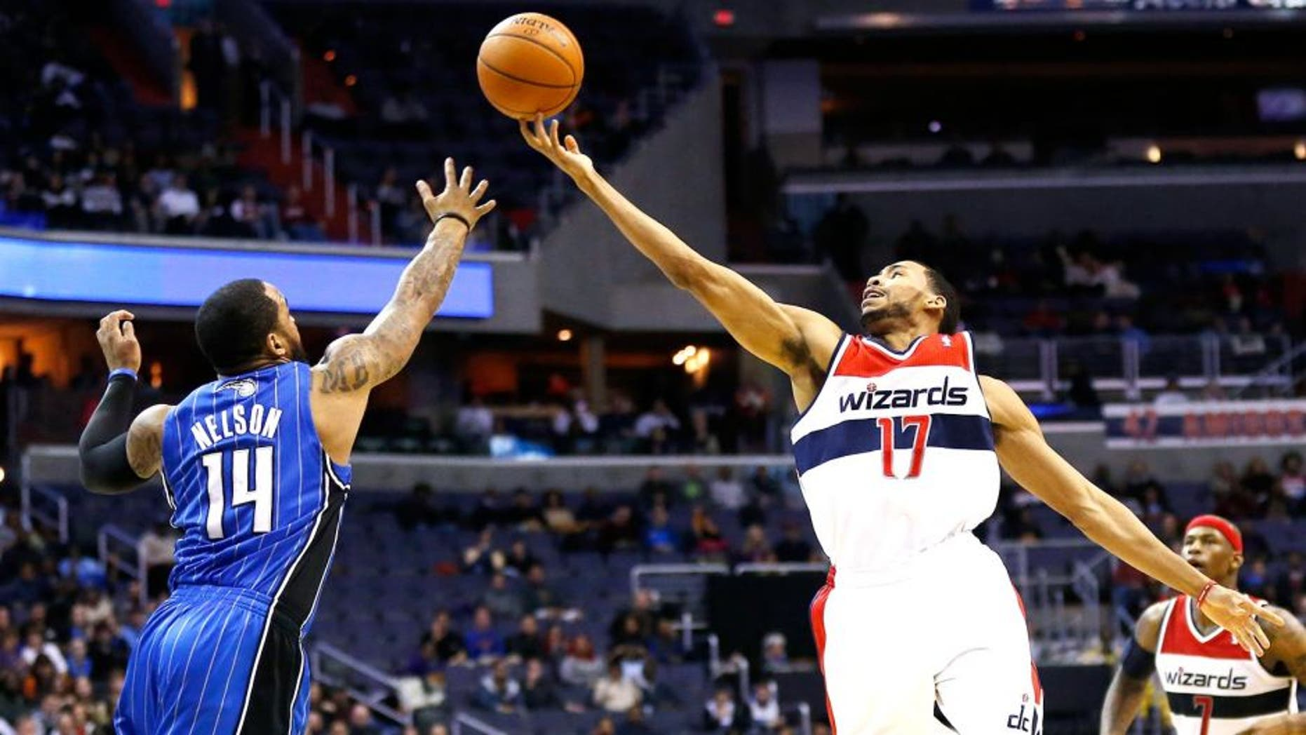 Feb 25, 2014; Washington, DC, USA; Washington Wizards shooting guard Garrett Temple (17) and Orlando Magic point guard Jameer Nelson (14) battle for the ball in the second quarter at Verizon Center. Mandatory Credit: Geoff Burke-USA TODAY Sports
