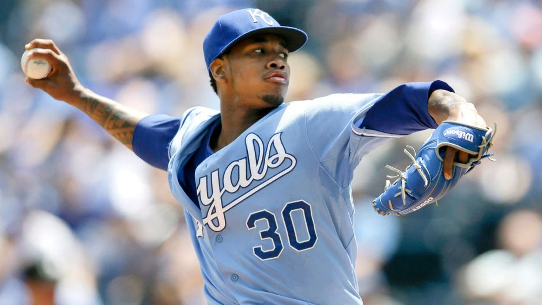 Kansas City Royals starting pitcher Yordano Ventura delivers to a Texas Rangers batter during the first inning of a baseball game at Kauffman Stadium in Kansas City, Mo., Saturday, June 6, 2015. (AP Photo/Orlin Wagner)