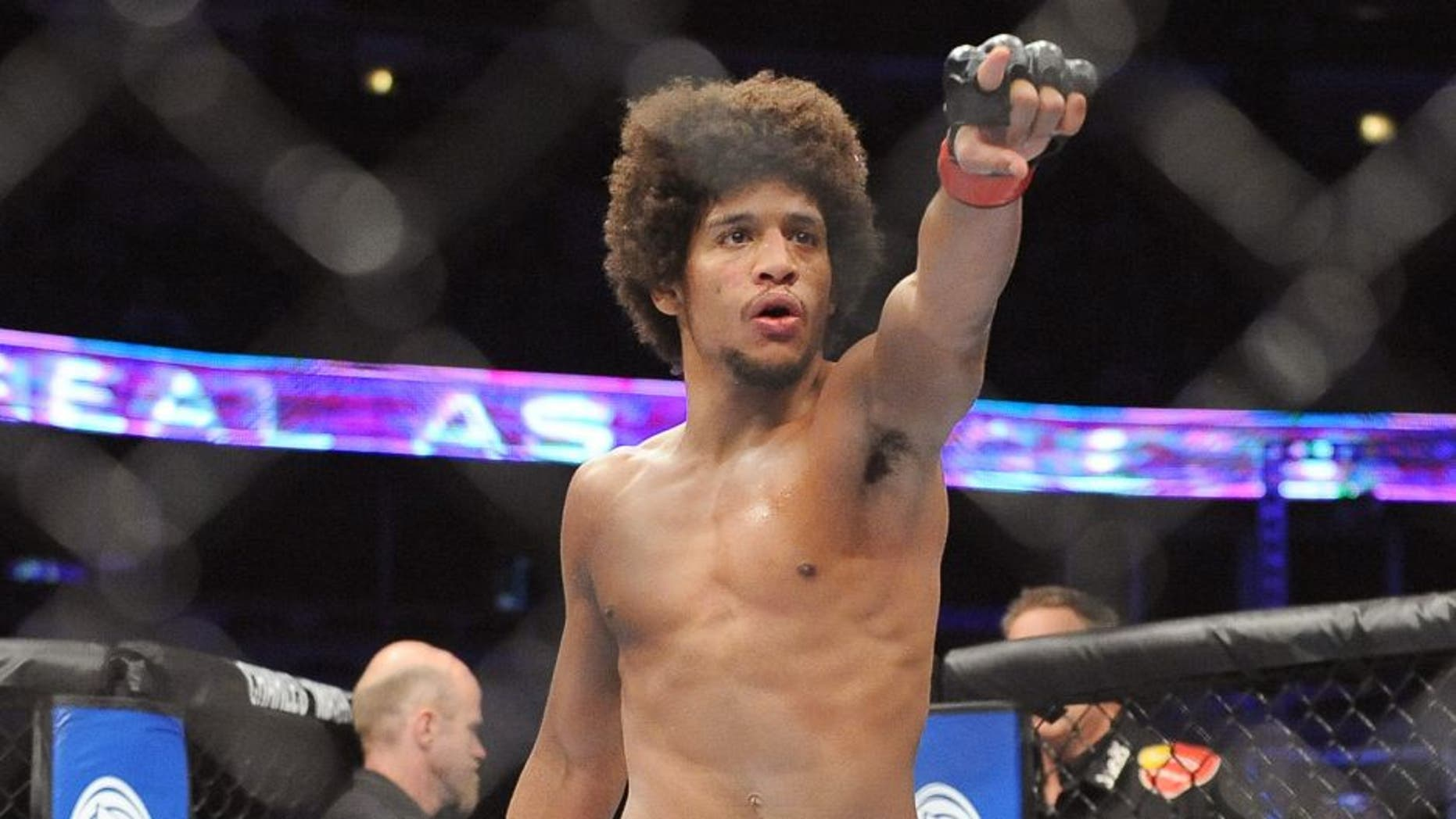 CHICAGO, ILLINOIS - JANUARY 25, 2014: Alex Caceres celebrates after a submission win after a bantamweight bout during UFC on Fox 10 Henderson v Thomson at United Center in Chicago, Illinois. (Photo by David Dermer/Diamond Images/Getty Images)