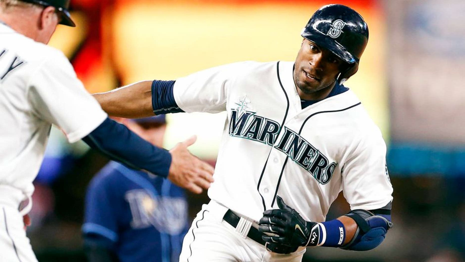 Jun 6, 2015; Seattle, WA, USA; Seattle Mariners center fielder Austin Jackson (16) runs around the bases after hitting a solo-homer against the Tampa Bay Rays during the eighth inning at Safeco Field. Mandatory Credit: Jennifer Buchanan-USA TODAY Sports