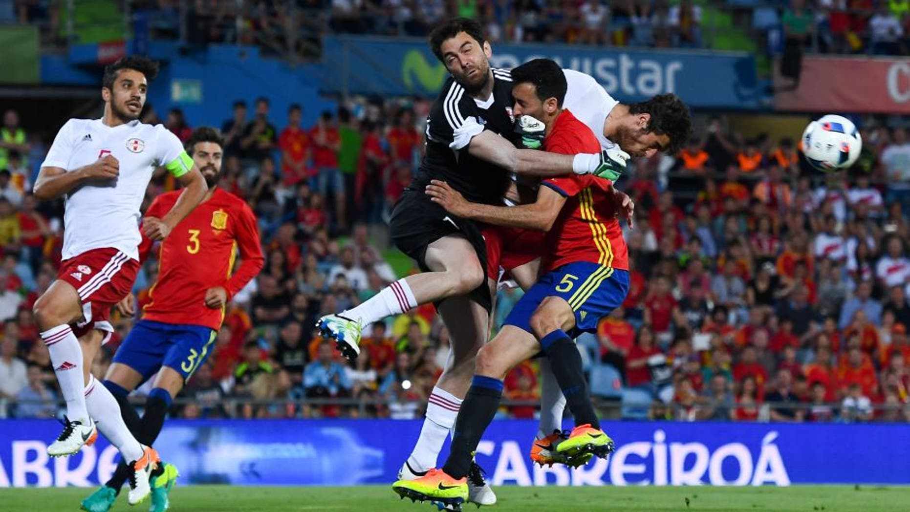 GETAFE, SPAIN - JUNE 07: Sergio Busquets of Spain collides with the goalkeeper Revishvili of Georgia during an international friendly match between Spain and Georgia at Alfonso Perez stadium on June 7, 2016 in Getafe, Spain. (Photo by David Ramos/Getty Images)