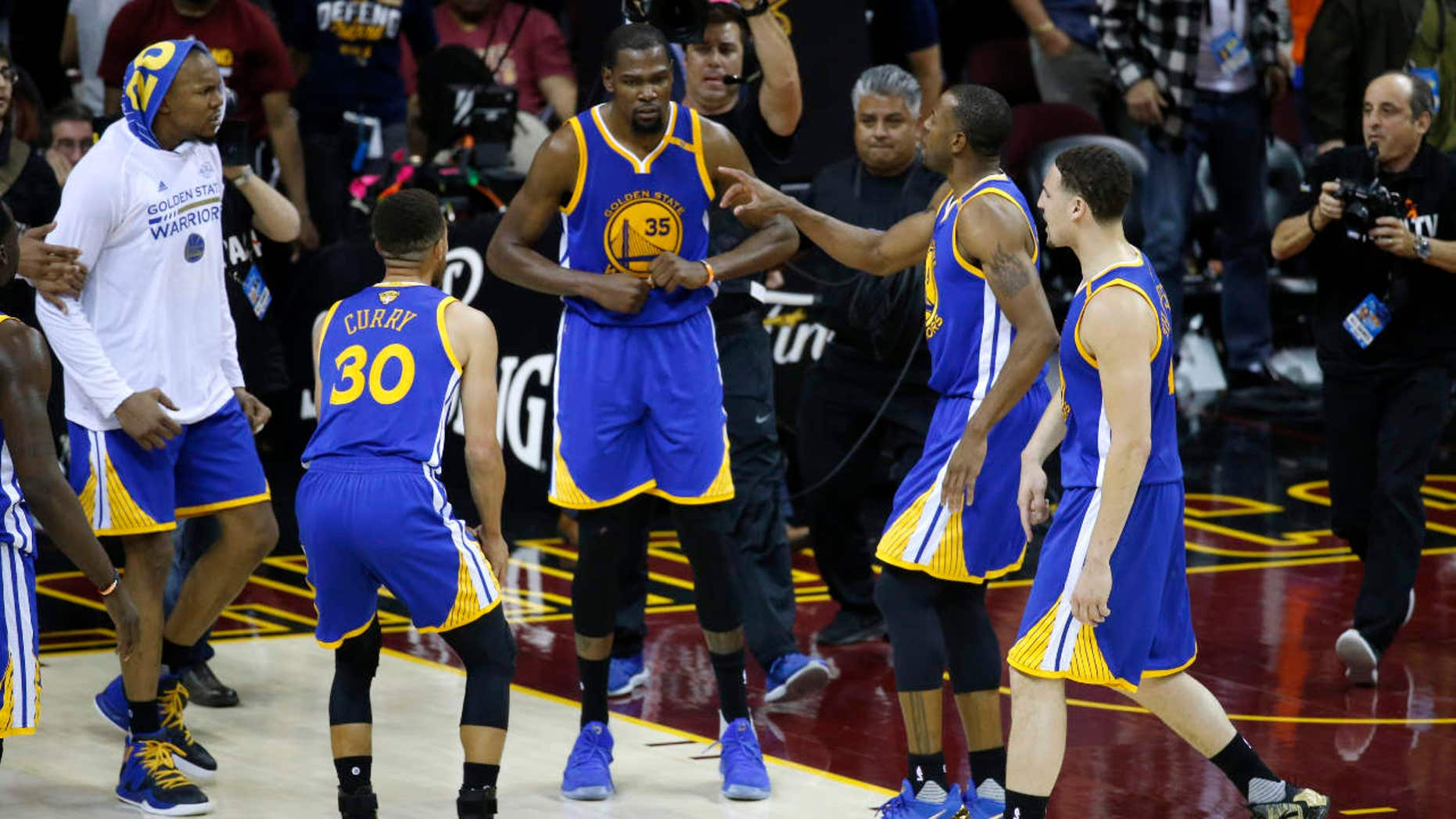 Golden State Warriors forward Kevin Durant (35) celebrates with teammates after the Warriors defeated the Cleveland Cavaliers 118-113 in Game 3 of basketball's NBA Finals in Cleveland, Wednesday, June 7, 2017.