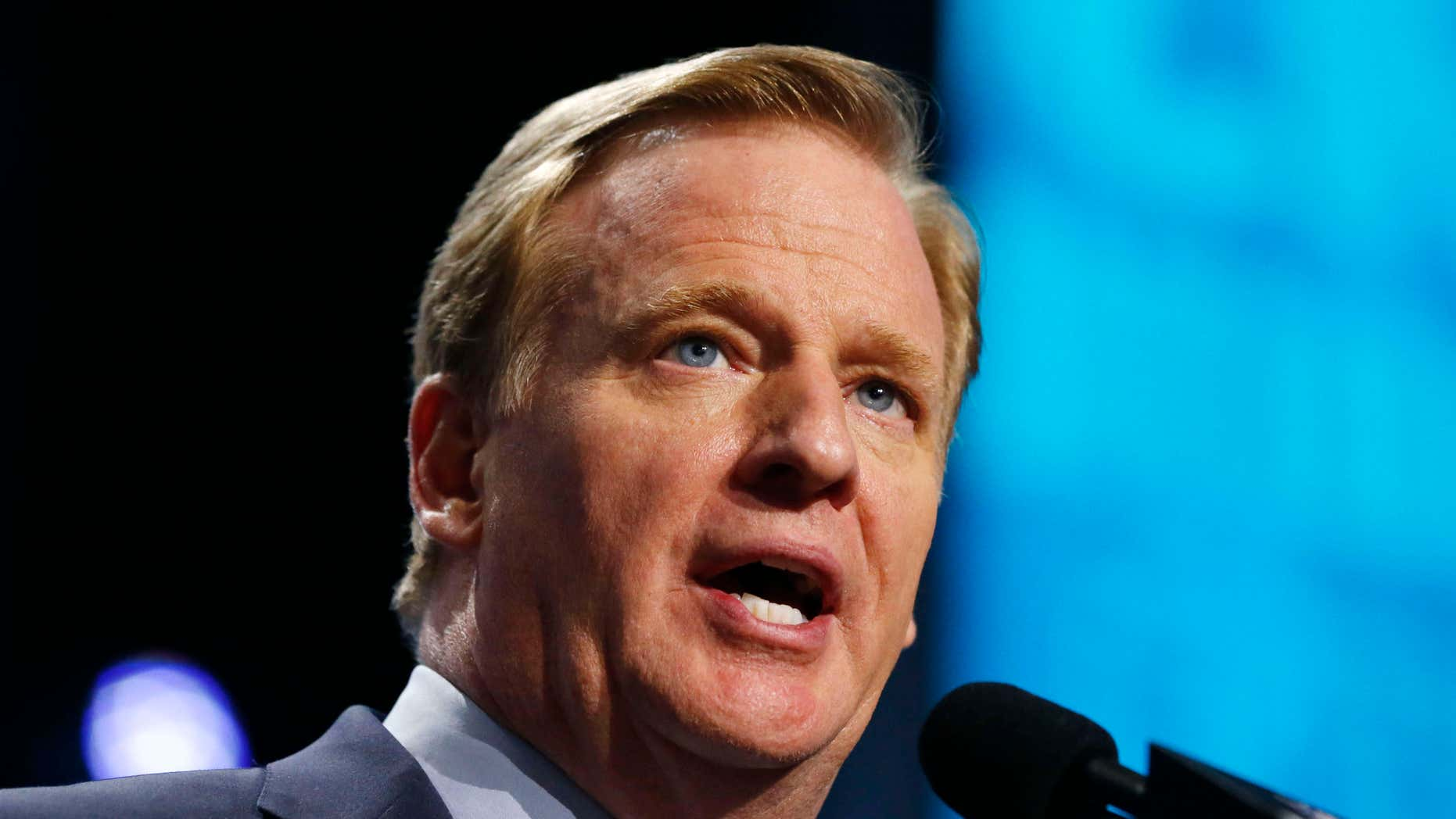 FILE - In this Thursday, April 28, 2016 file photo, NFL commissioner Roger Goodell announces a selection during the first round of the 2016 NFL football draft in Chicago.