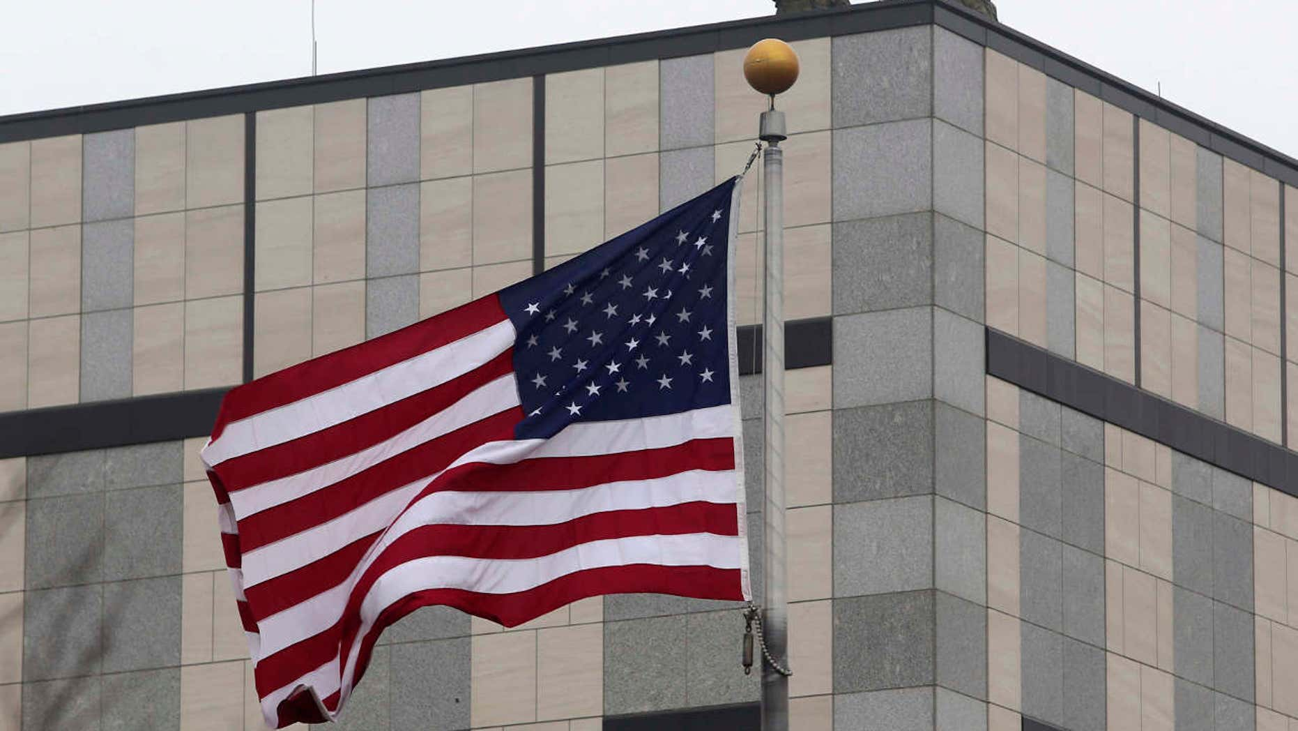 Guards are seen on the roof of the U.S. embassy in Kiev.