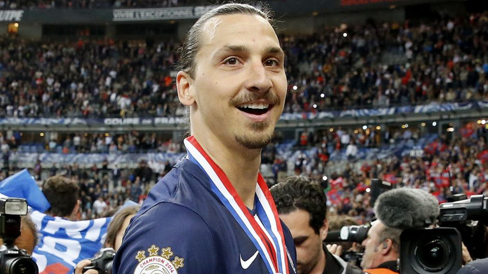 PARIS, FRANCE - MAY 30: Zlatan Ibrahimovic of PSG celebrates the victory after the French Cup Final between Paris Saint-Germain (PSG) and AJ Auxerre at Stade de France on May 30, 2015 in Saint-Denis nearby Paris, France. (Photo by Jean Catuffe/Getty Images)