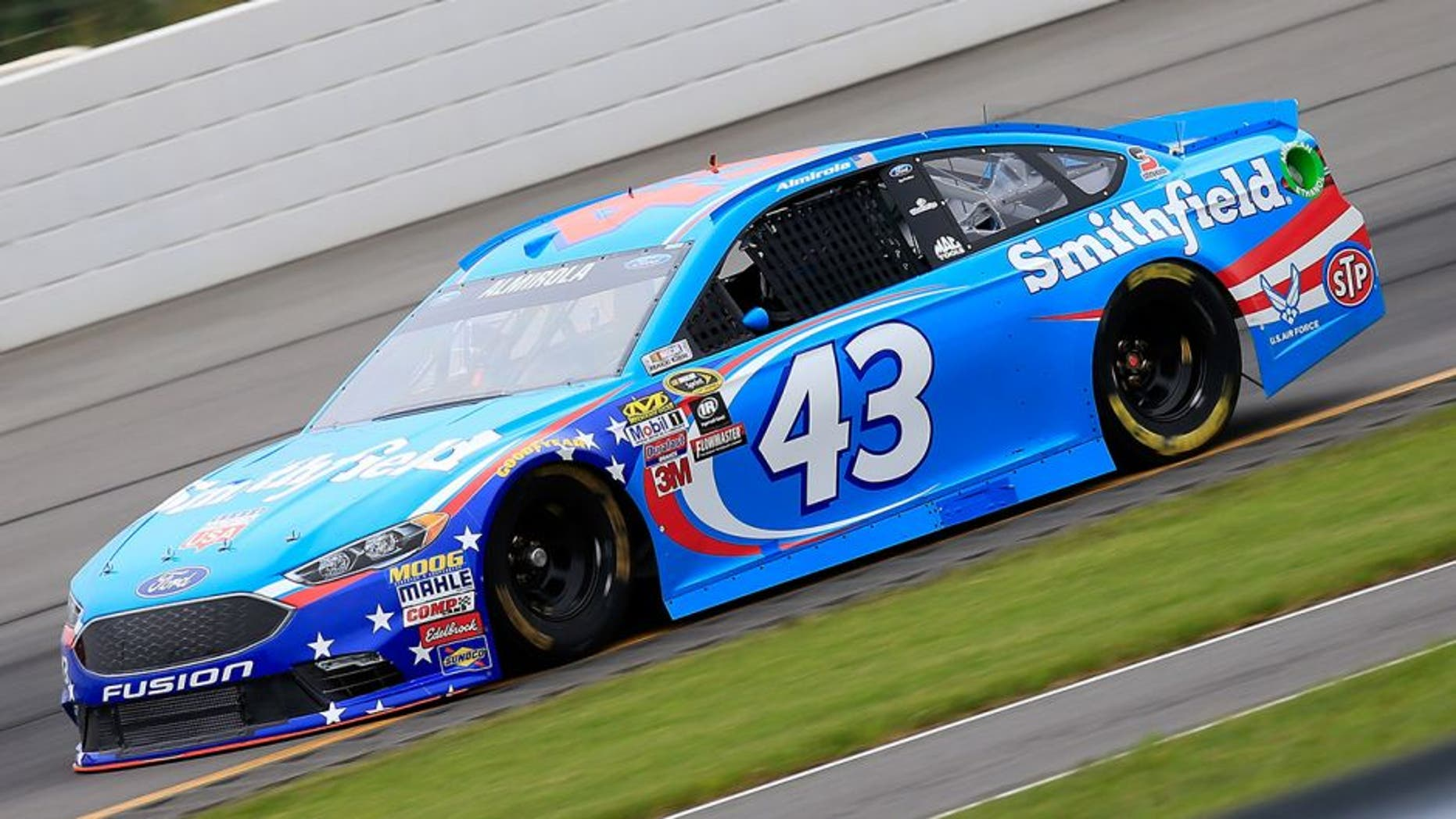 "LONG POND, PA - JUNE 03: Aric Almirola, driver of the #43 Smithfield Ford, qualifies for the NASCAR Sprint Cup Series Axalta ""We Paint Winners"" 400 at Pocono Raceway on June 3, 2016 in Long Pond, Pennsylvania. (Photo by Chris Trotman/NASCAR via Getty Images)"