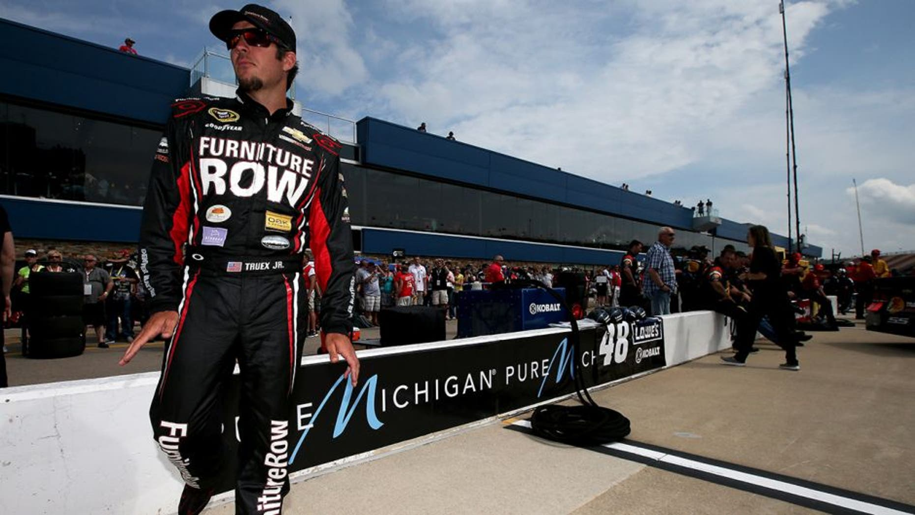 BROOKLYN, MI - JUNE 12: Martin Truex Jr., driver of the #78 Furniture Row/Visser Precision Chevrolet, stands on the grid during qualifying for the NASCAR Sprint Cup Series Quicken Loans 400 at Michigan International Speedway on June 12, 2015 in Brooklyn, Michigan. (Photo by Sean Gardner/NASCAR via Getty Images)