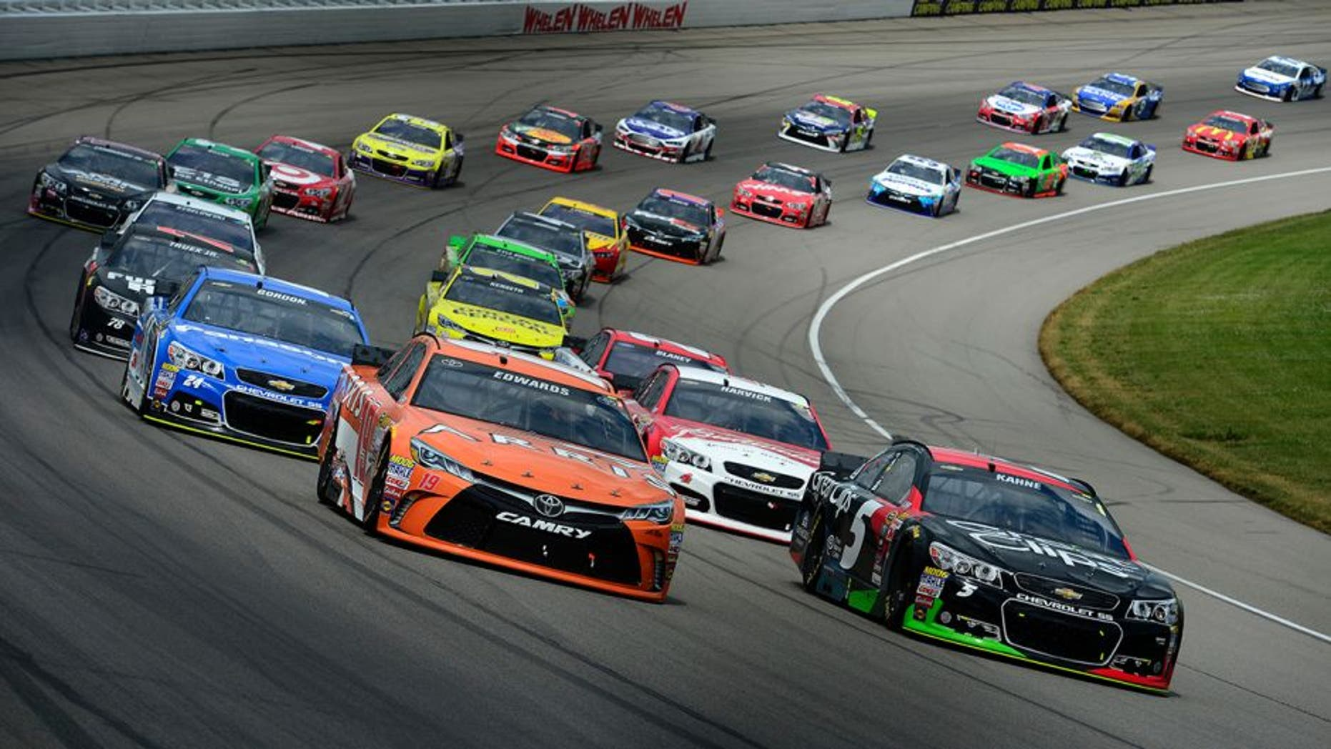 BROOKLYN, MI - JUNE 14: Carl Edwards, driver of the #19 ARRIS Toyota, and Kasey Kahne, driver of the #5 Great Clips Chevrolet, lead a pack of cars during the NASCAR Sprint Cup Series Quicken Loans 400 at Michigan International Speedway on June 14, 2015 in Brooklyn, Michigan. (Photo by Robert Laberge/NASCAR via Getty Images)
