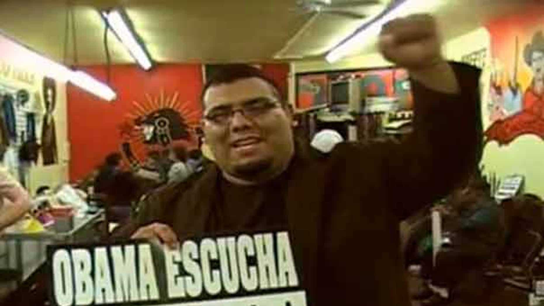 "May 28: Jose Lara, a social studies teacher in the Los Angeles Unified School District, took students on an overnight ""freedom ride"" to Phoenix to protest what he called the ""racist and outrageous"" new immigration law in Arizona. He is seen above holding a sign in Spanish that reads, 'Listen Obama.'"