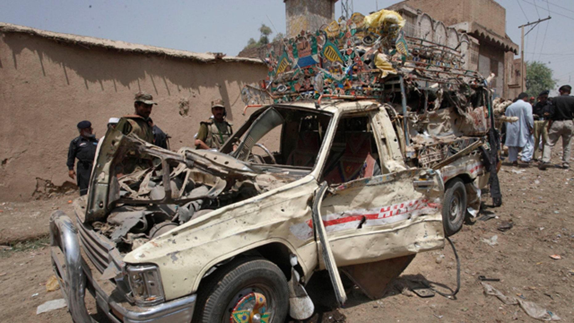 June 9: Pakistani security officials visit the site of a blast in Matani Near Peshawar, Pakistan.