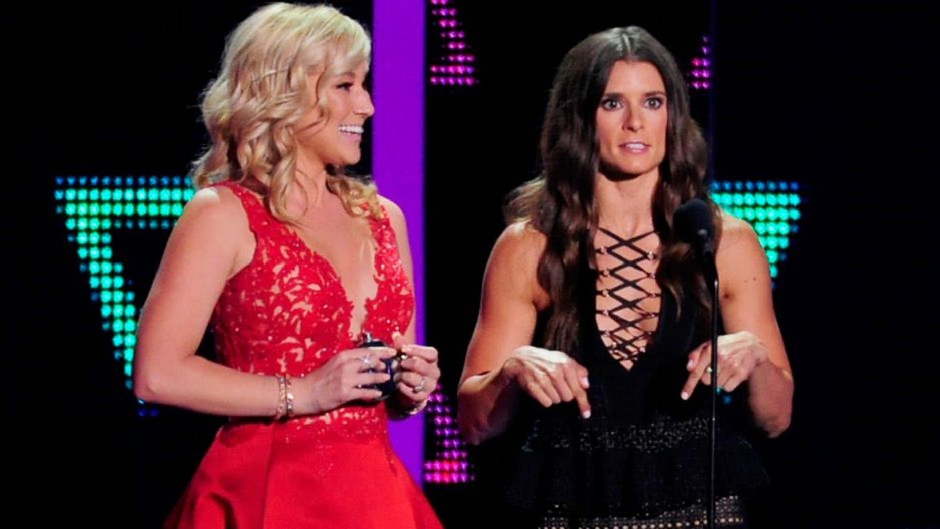 NASHVILLE, TN - JUNE 08: Musical artist Kellie Pickler and race car driver Danica Patrick onstage during the 2016 CMT Music awards at the Bridgestone Arena on June 8, 2016 in Nashville, Tennessee. (Photo by FilmMagic/FilmMagic)