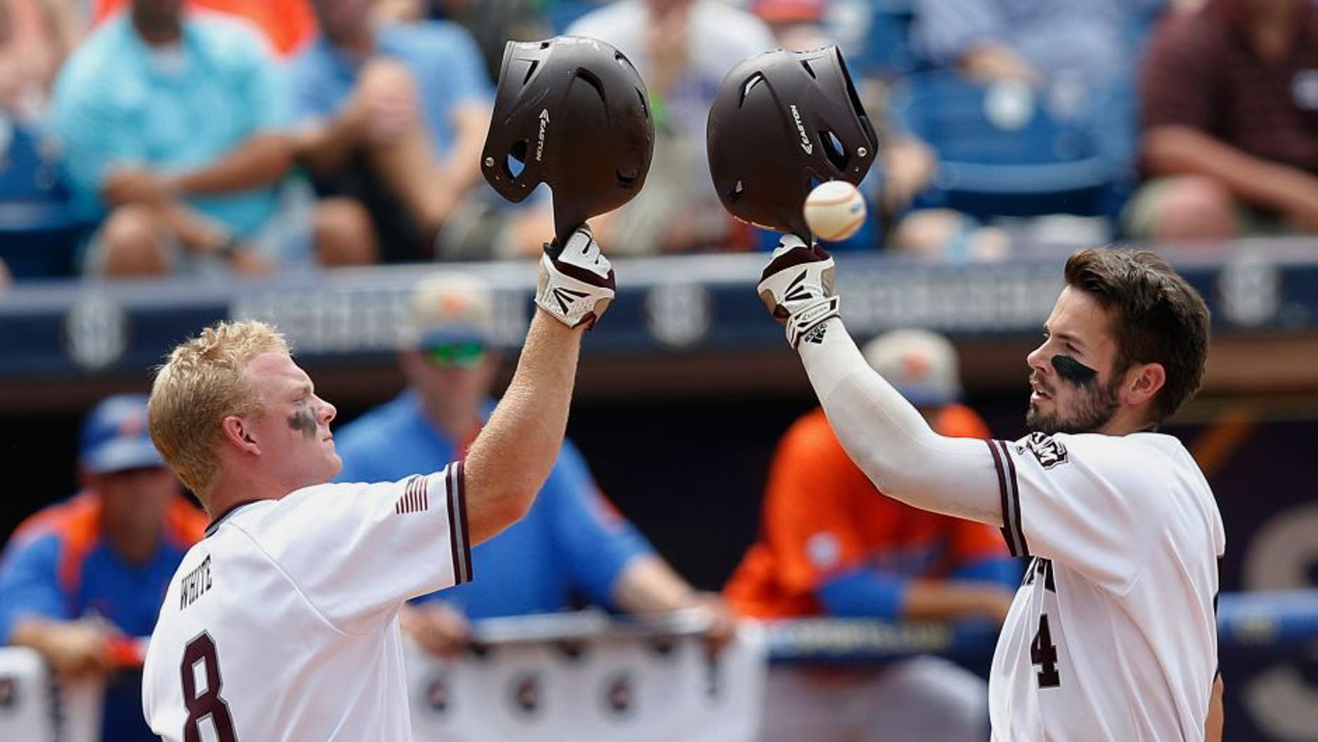 Texas A&M's Nick Banks, right, celebrates with Boomer White after Banks hits a solo home run in the third inning of the Southeastern Conference NCAA college baseball championship game at the Hoover Met, Sunday, May 29, 2016, in Hoover, Ala. Texas A&M won 12-5. (AP Photo/Brynn Anderson)