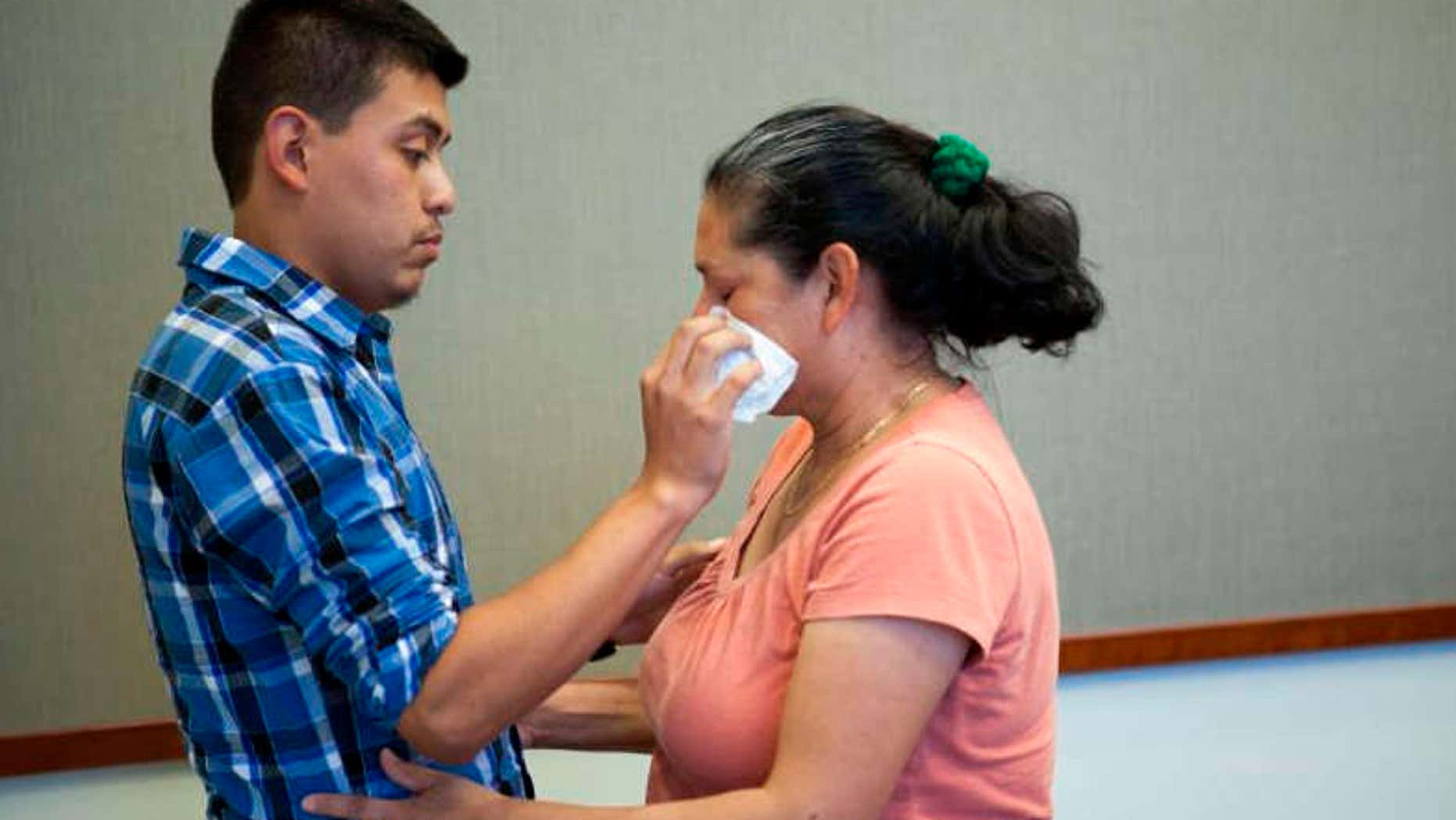 June 9, 2016: Steve Hernandez wipes a tear from his mother's eye after seeing her for the first time in 20 years in San Diego, Calif..