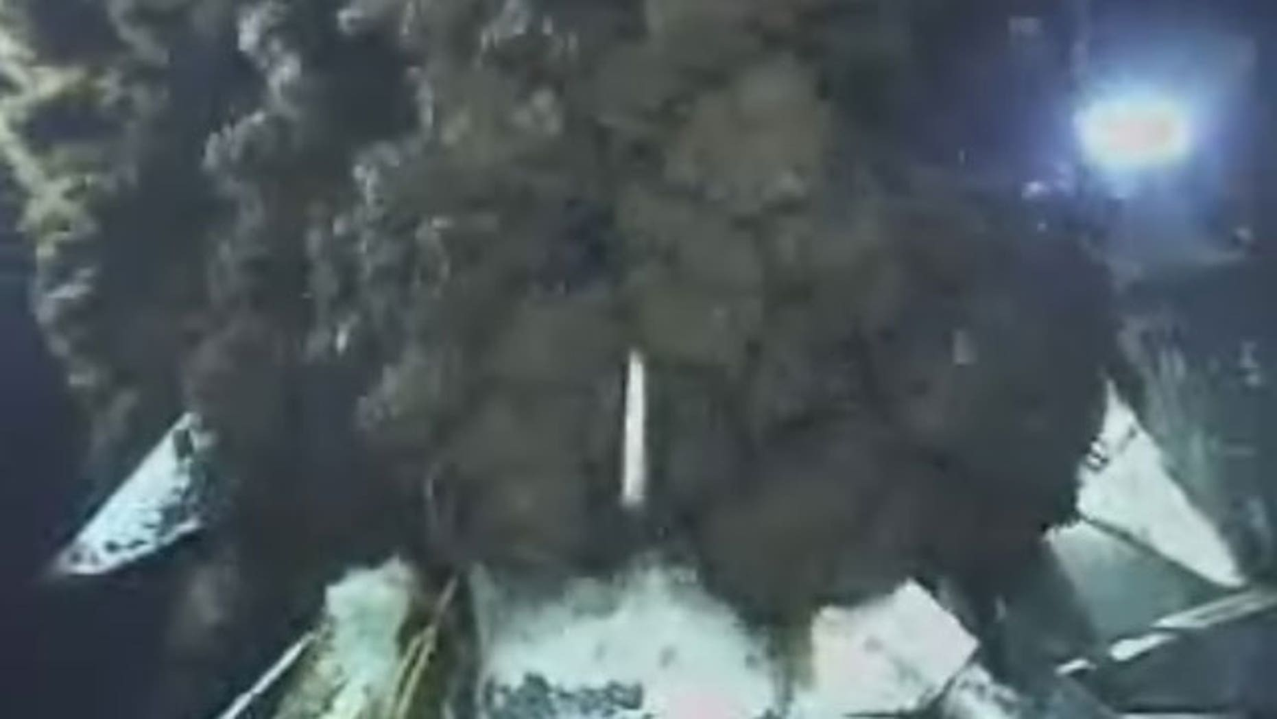 June 10: This image from video provided by BP PLC shows oil continuing to pour out at the site of the Deepwater Horizon oil well in the Gulf of Mexico.