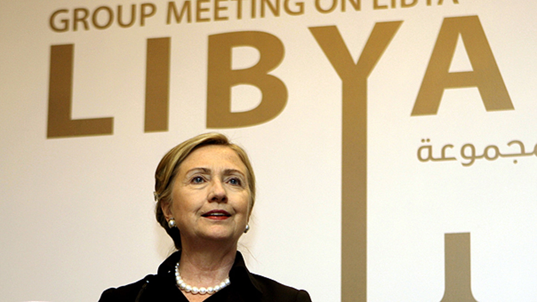 June 9: Secretary of State Hillary Clinton talks to journalists during the third meeting of Contact Group on Libya in Abu Dhabi, United Arab Emirates.