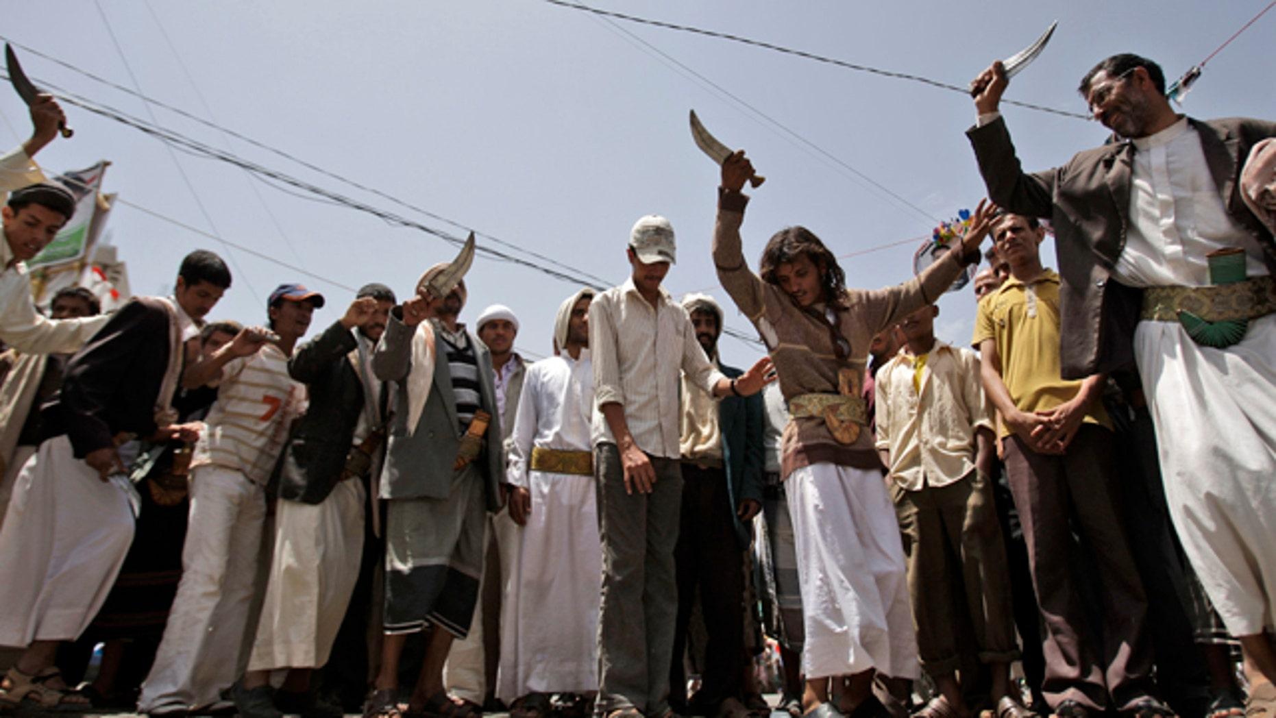 June 9: Anti-government protestors dance holding up daggers during a demonstration demanding the resignation of Yemeni President Ali Abdullah Saleh, in Sanaa, Yemen.