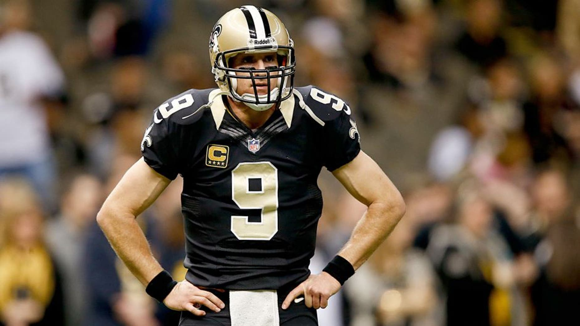 Dec 29, 2013; New Orleans, LA, USA; New Orleans Saints quarterback Drew Brees (9) prior to kickoff of a game against the Tampa Bay Buccaneers at the Mercedes-Benz Superdome. Mandatory Credit: Derick E. Hingle-USA TODAY Sports