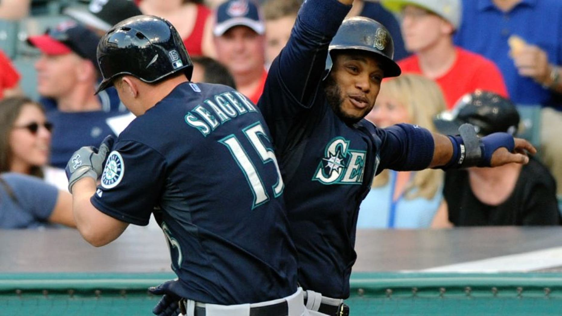 Jun 10, 2015; Cleveland, OH, USA; Seattle Mariners third baseman Kyle Seager (15) celebrates with second baseman Robinson Cano (22) after hitting a grand slam home run during the third inning against the Cleveland Indians at Progressive Field. Mandatory Credit: Ken Blaze-USA TODAY Sports