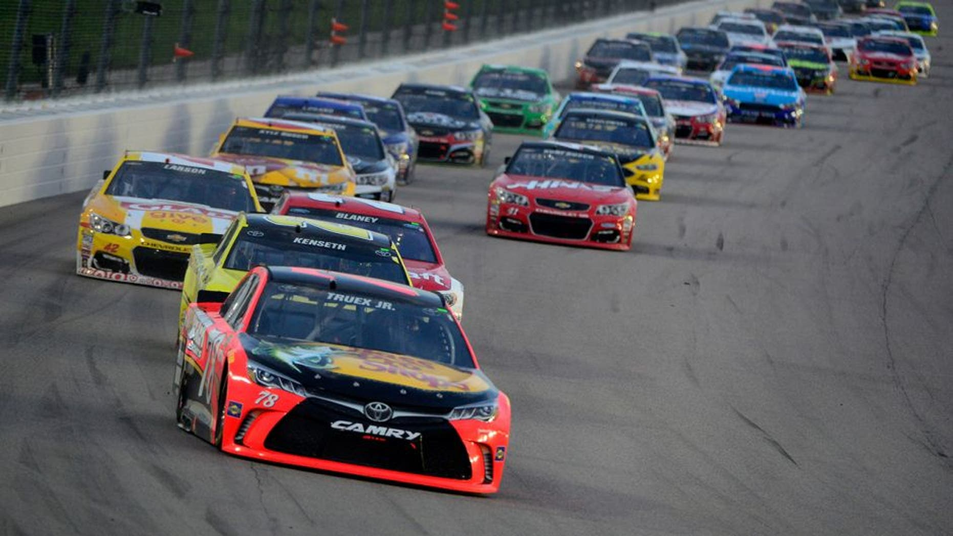 KANSAS CITY, KS - MAY 07: Martin Truex Jr., driver of the #78 Bass Pro Shops/TRACKER Boats Toyota Toyota, and Matt Kenseth, driver of the #20 Dollar General Toyota, leads the field during the NASCAR Sprint Cup Series Go Bowling 400 at Kansas Speedway on May 7, 2016 in Kansas City, Kansas. (Photo by Robert Laberge/NASCAR via Getty Images)