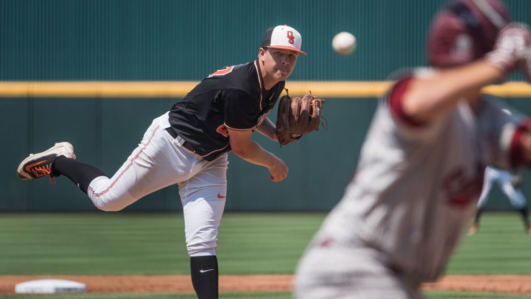 Oklahoma State pitcher Tyler Buffett delivers a pitch during an NCAA college baseball tournament super regional game against South Carolina on Sunday, June 12, 2016, in Columbia, S.C. (AP Photo/Sean Rayford)