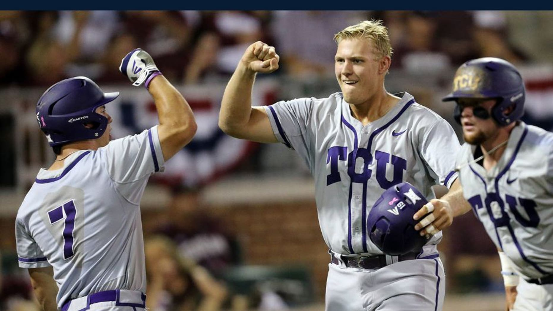 TCU's Luken Baker (19) celebrates with teammate Josh Watson (7) after a three run homer against Texas A&M during the third inning of an NCAA Super Regional baseball tournament game, Friday, June 10, 2016, in College Station, Texas. (AP Photo/Sam Craft)
