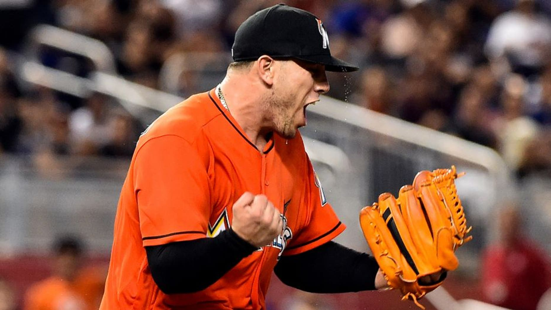 Jun 5, 2016; Miami, FL, USA; Miami Marlins starting pitcher Jose Fernandez (16) reacts on the pitchers mound during the seventh inning against the New York Mets at Marlins Park. The Marlins won 1-0. Mandatory Credit: Steve Mitchell-USA TODAY Sports
