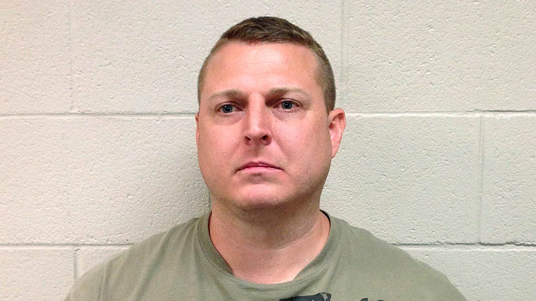 In this June 2016 photo released by the Hoke County (N.C.) Sheriff's Office, Thomas Russell Langford poses for a booking photograph.