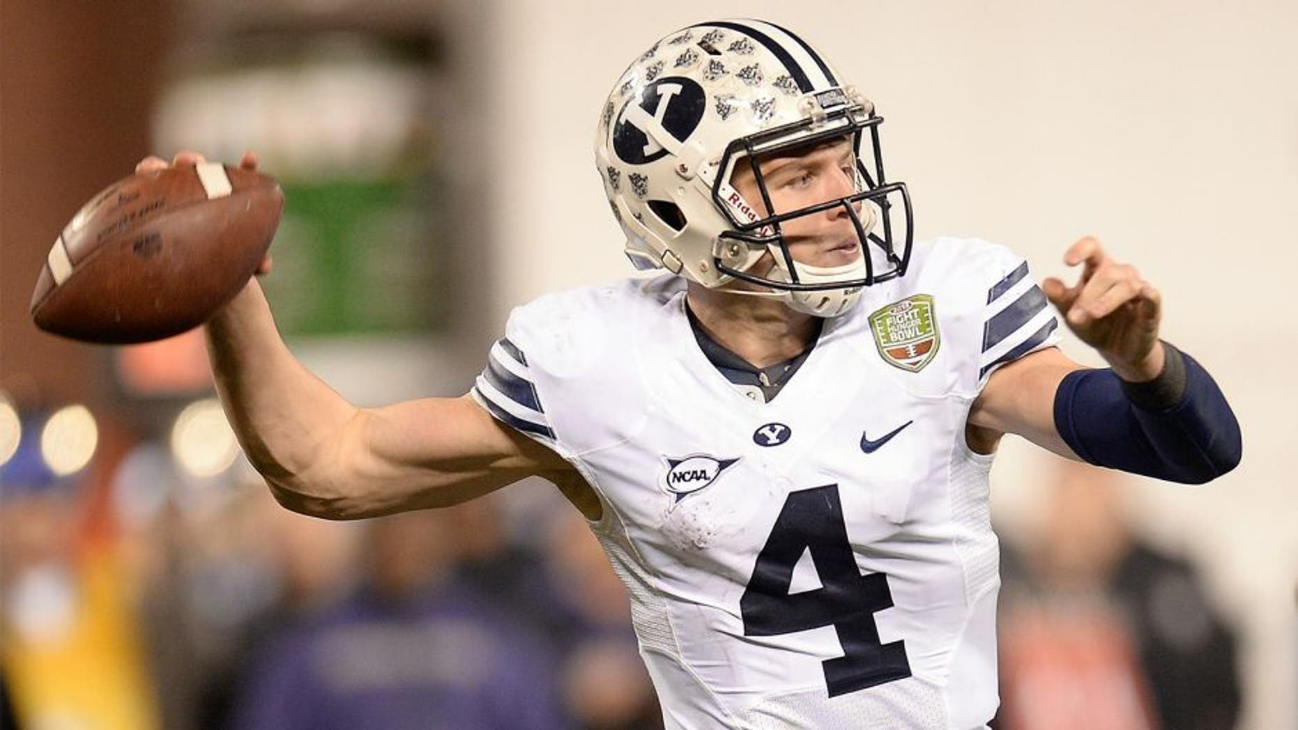 SAN FRANCISCO, CA - DECEMBER 27: Taysom Hill #4 of the BYU Cougars rolls out to pass against the Washington Huskies during the third quarter in the Fight Hunger Bowl at AT&T Park on December 27, 2013 in San Francisco, California. (Photo by Thearon W. Henderson/Getty Images) *** Local Caption *** Taysom Hill