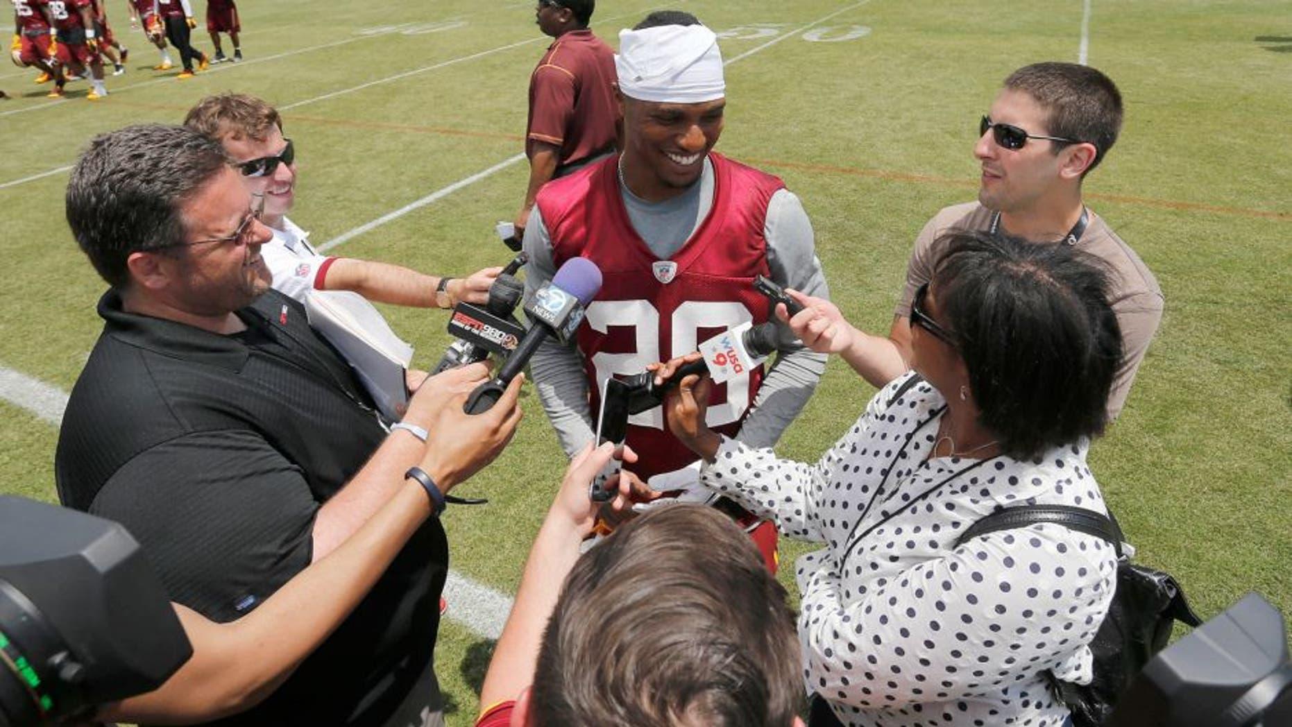 May 26, 2015; Ashbury, VA, USA; Washington Redskins cornerback Chris Culliver (29) speaks with the media after the Redskins OTA at Redskins Park. Mandatory Credit: Geoff Burke-USA TODAY Sports