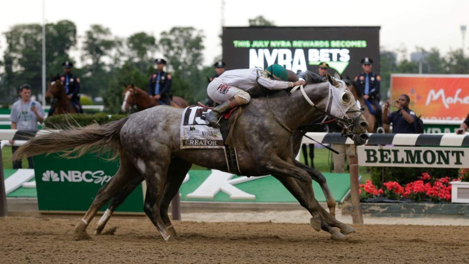 Creator, with jockey Irad Ortiz Jr. up, edges out Lani, with Yutaka Take up, to win the 148th running of the Belmont Stakes horse race, Saturday, June 11, 2016, in Elmont, N.Y. (AP Photo/Julie Jacobson)