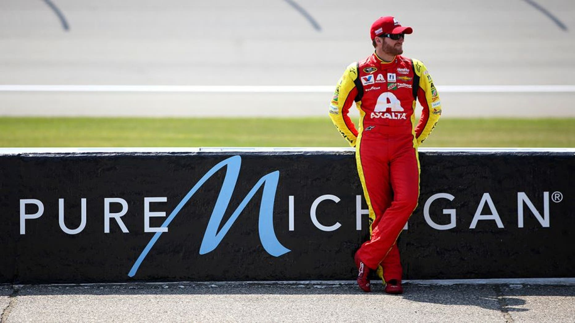 BROOKLYN, MI - JUNE 10: Dale Earnhardt Jr, driver of the #88 Axalta Chevrolet, stands on the grid during qualifying for the NASCAR Sprint Cup Series FireKeepers Casino 400 at Michigan International Speedway on June 10, 2016 in Brooklyn, Michigan. (Photo by Sean Gardner/NASCAR via Getty Images)