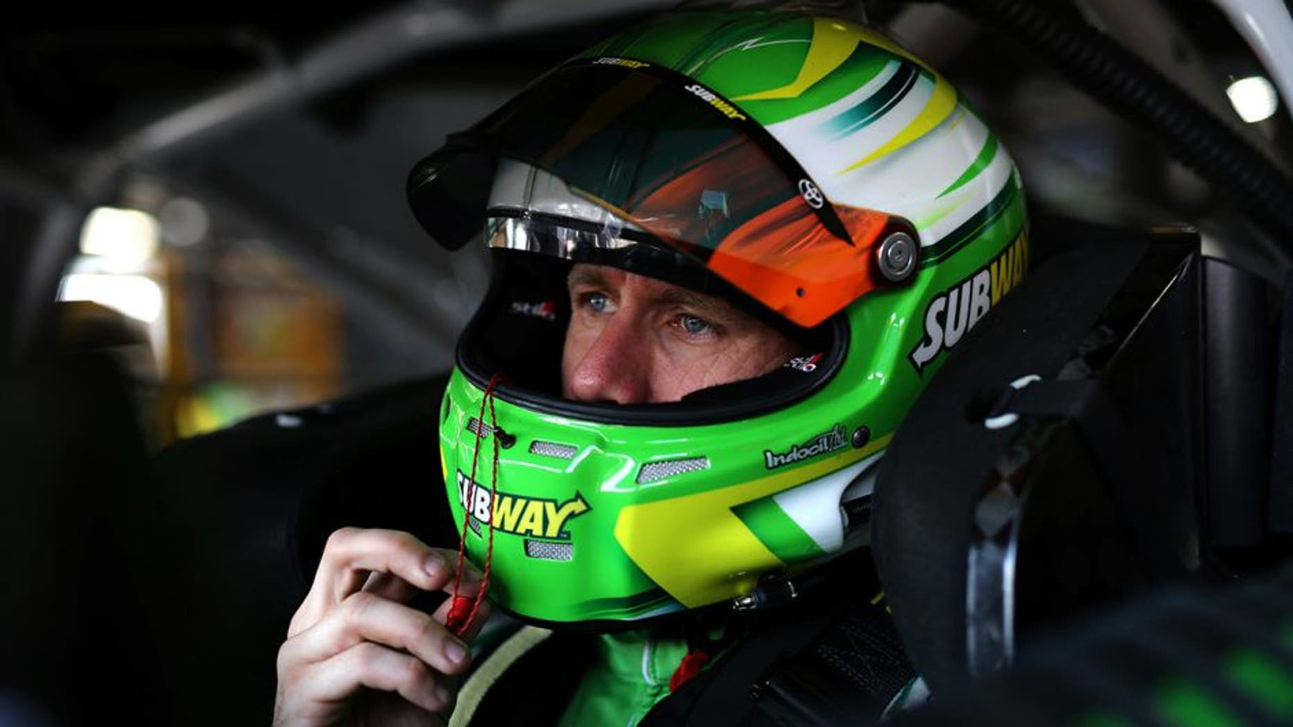 BROOKLYN, MI - JUNE 11: Carl Edwards, driver of the #19 Subway Toyota, sits in his car during practice for the NASCAR Sprint Cup Series FireKeepers Casino 400 at Michigan International Speedway on June 11, 2016 in Brooklyn, Michigan. (Photo by Rey Del Rio/Getty Images )