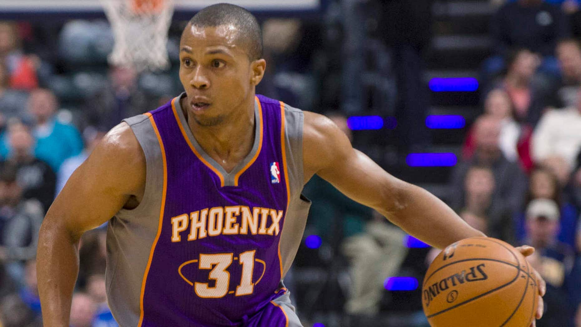 FILE - In this Dec. 28, 2012, file photo, Phoenix Suns' Sebastian Telfair brings the ball up against Indiana Pacers' Tyler Hansbrough during a basketball game in Indianapolis.