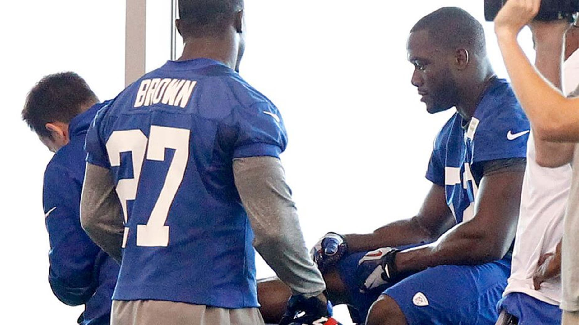 Jun 12, 2014; East Rutherford, NJ, USA; New York Giants outside linebacker Jon Beason (52) is tended to on the sidelines during New York Giants minicamp at the Quest Diagnostics Training Center. William Perlman/The Star-Ledger-USA TODAY Sports