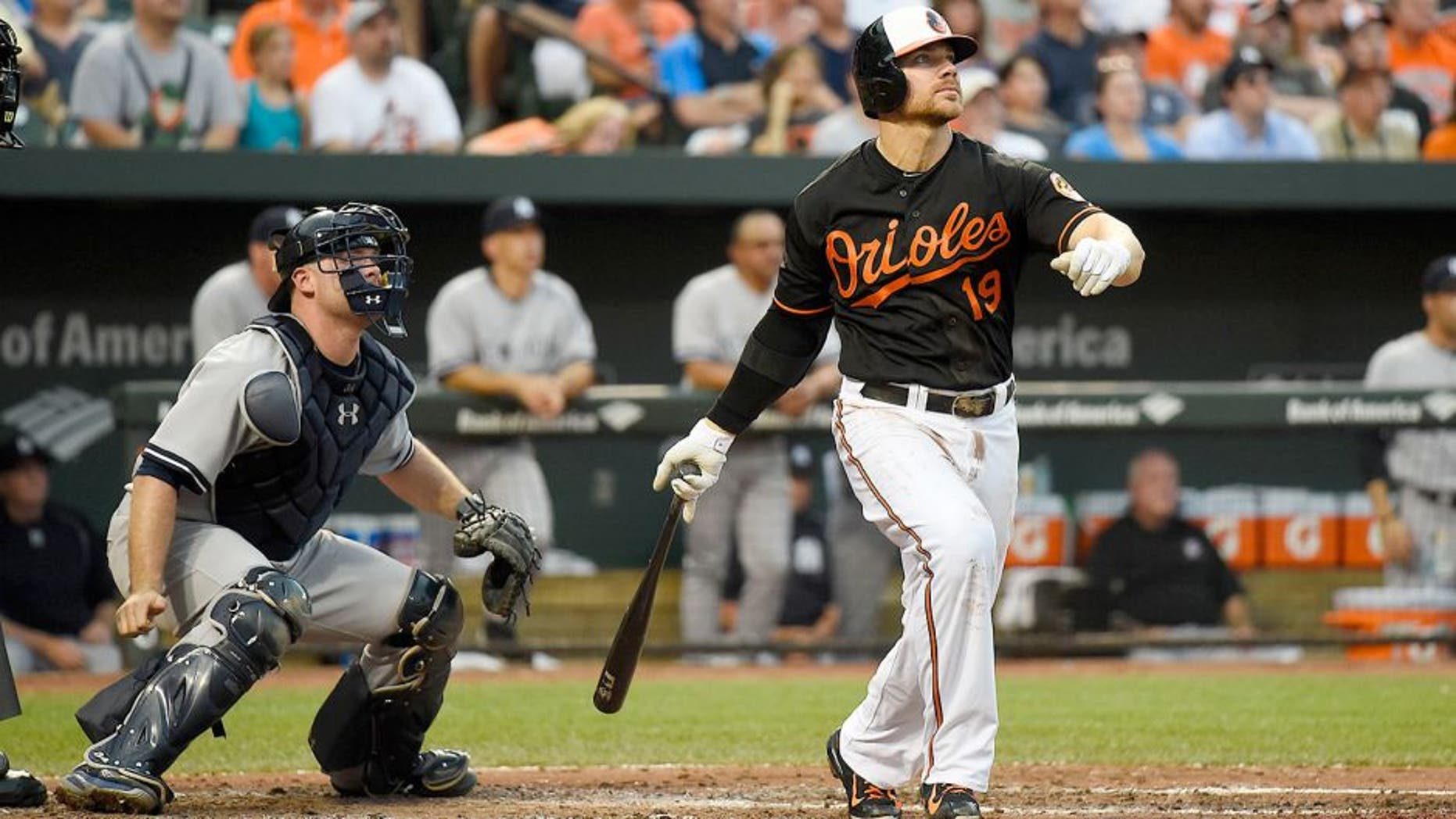 Jun 12, 2015; Baltimore, MD, USA; Baltimore Orioles first baseman Chris Davis (19) hits a three run home run during the third inning against the New York Yankees at Oriole Park at Camden Yards. Mandatory Credit: Tommy Gilligan-USA TODAY Sports