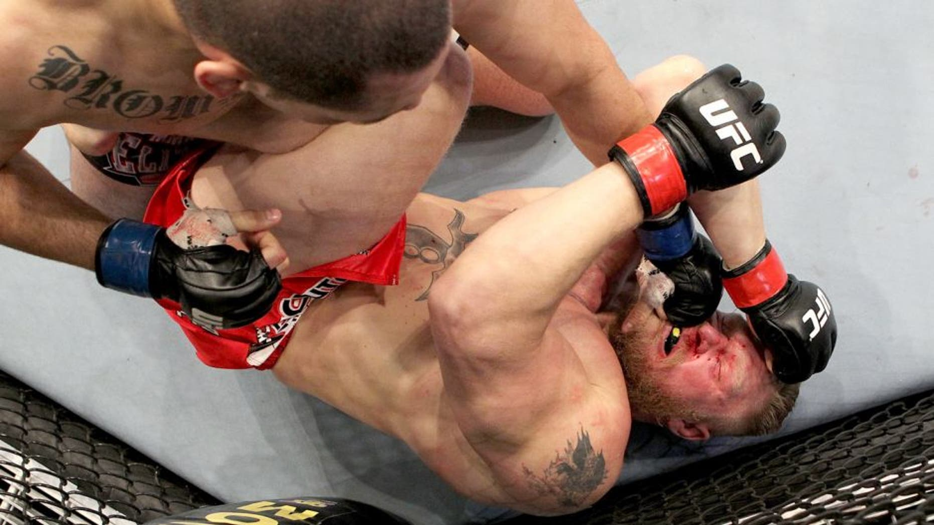 ANAHEIM, CA - OCTOBER 23: (L-R) Cain Velasquez connects on a left to the face of Brock Lesnar in the first round during the heavyweight title bout during UFC 121 on October 23, 2010 in Anaheim, California. Velasquez defeated Lenar by first round TKO to become the new UFC heavyweight champion. (Photo by Josh Hedges/Zuffa LLC/Zuffa LLC via Getty Images) *** Local Caption *** Brock Lesnar;Cain Velasquez