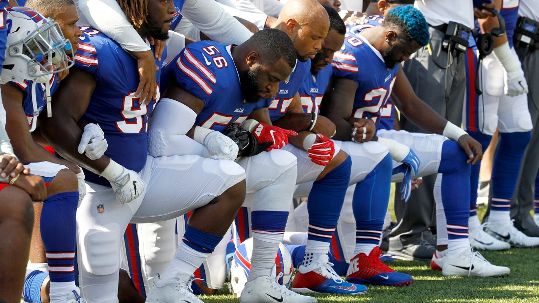 Buffalo Bills players kneel during the national anthem before a game versus the Denver Broncos.