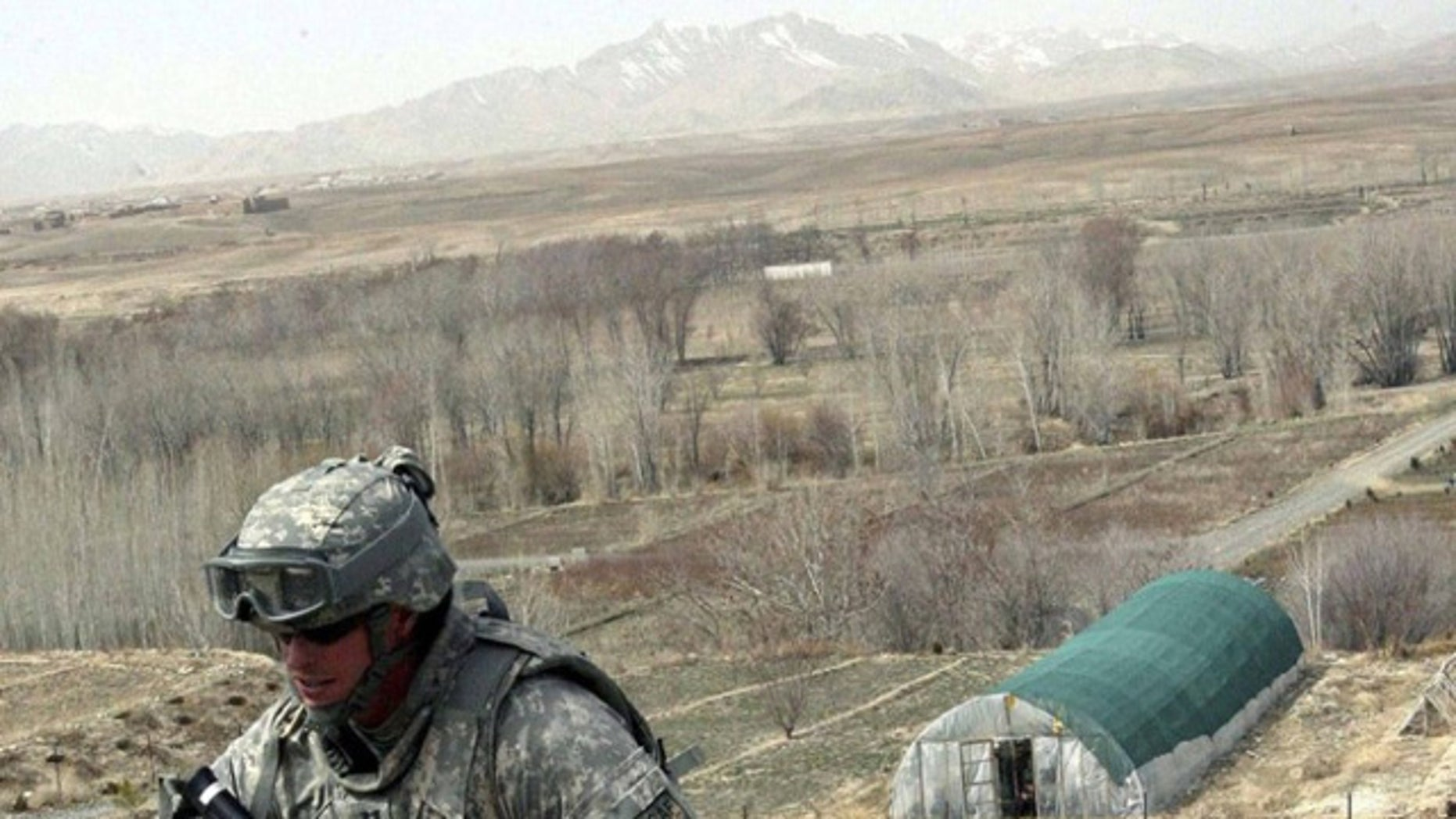 March 14: A U.S. soldier walks through Ghazni Province, a region U.S. officials believe may hold a vast deposit of minerals.