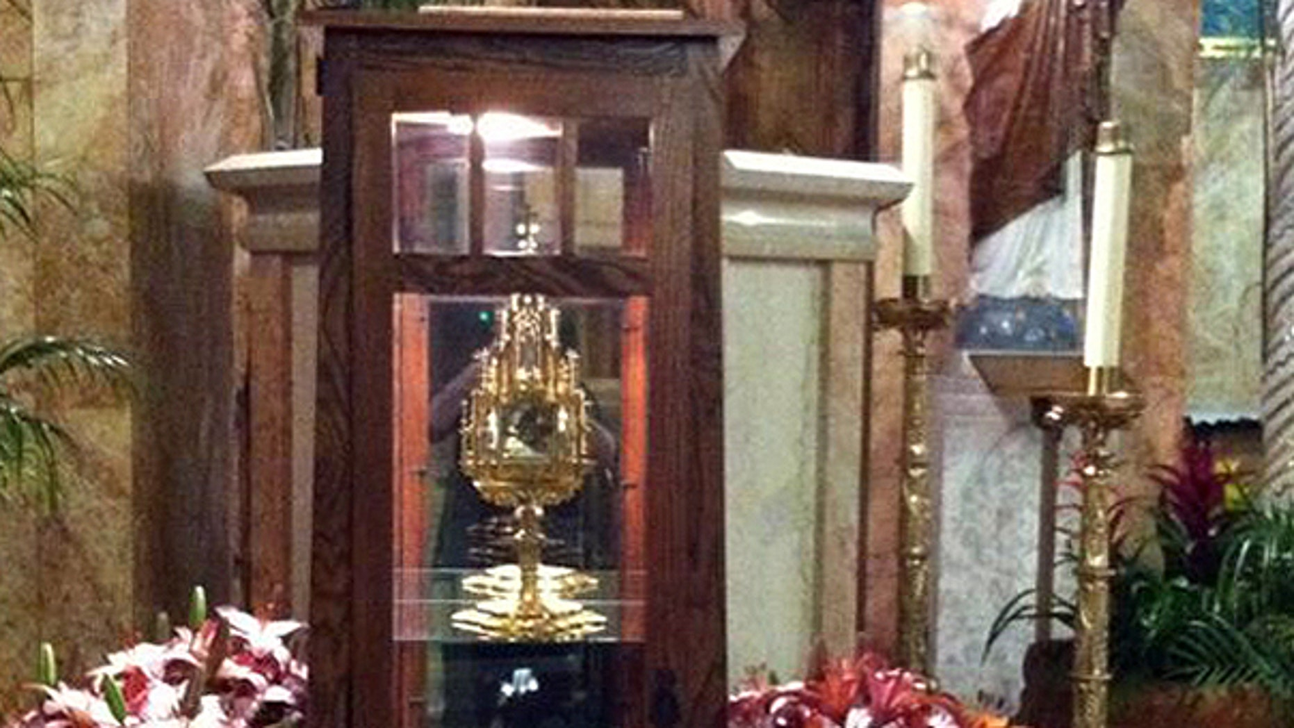 June 13: This undated photo provided by Father Brian Doran of the St. Anthony Catholic Church in Long Beach, Calif. via the Long Beach Police Department shows a 780-year-old religious relic of St. Anthony, the patron saint of lost causes and missing objects, center in cabinet, that was stolen from the church.