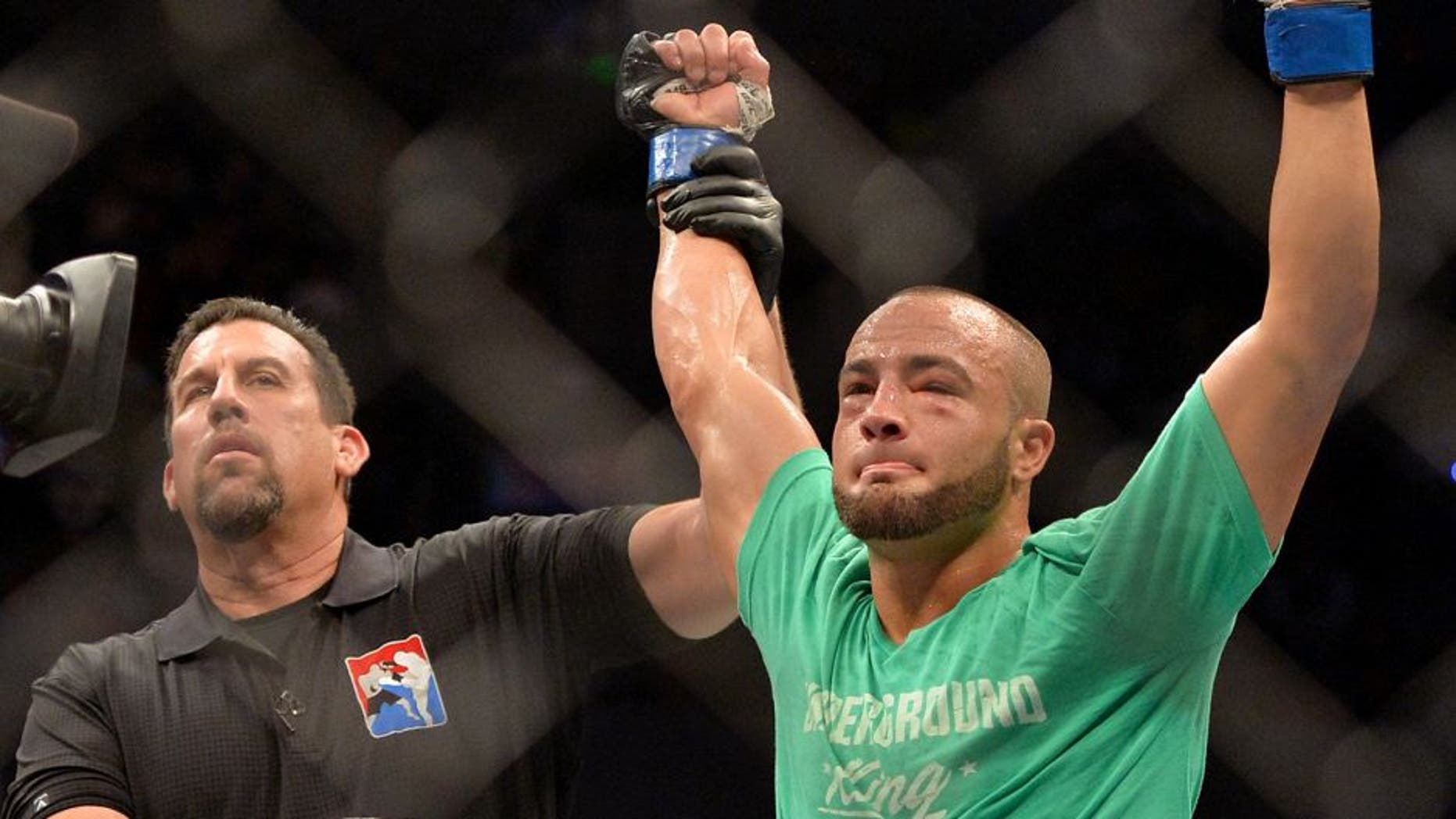MEXICO CITY, MEXICO - JUNE 13: Eddie Alvarez of the United States celebrates his victory over Gilbert Melendez of the United States in their lightweight bout during the UFC 188 event at the Arena Ciudad de Mexico on June 13, 2015 in Mexico City, Mexico. (Photo by Jeff Bottari/Zuffa LLC/Zuffa LLC via Getty Images)