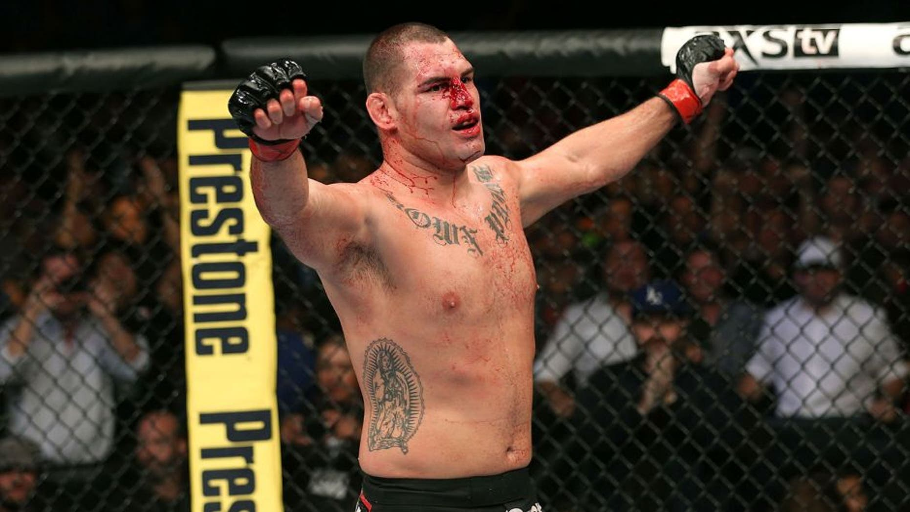 HOUSTON, TEXAS - OCTOBER 19: Cain Velasquez celebrates after defeating Junior Dos Santos (not pictured) by TKO in their UFC heavyweight championship bout at the Toyota Center on October 19, 2013 in Houston, Texas. (Photo by Nick Laham/Zuffa LLC/Zuffa LLC via Getty Images)