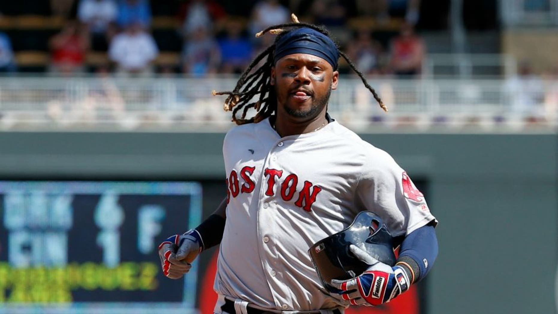 Boston Red Sox's Hanley Ramirez carries his batting helmet while running to third base on a throwing error by Minnesota Twins catcher Juan Centeno during the eighth inning of a baseball game in Minneapolis, Sunday, June 12, 2016. The Twins won 7-4. (AP Photo/Ann Heisenfelt)