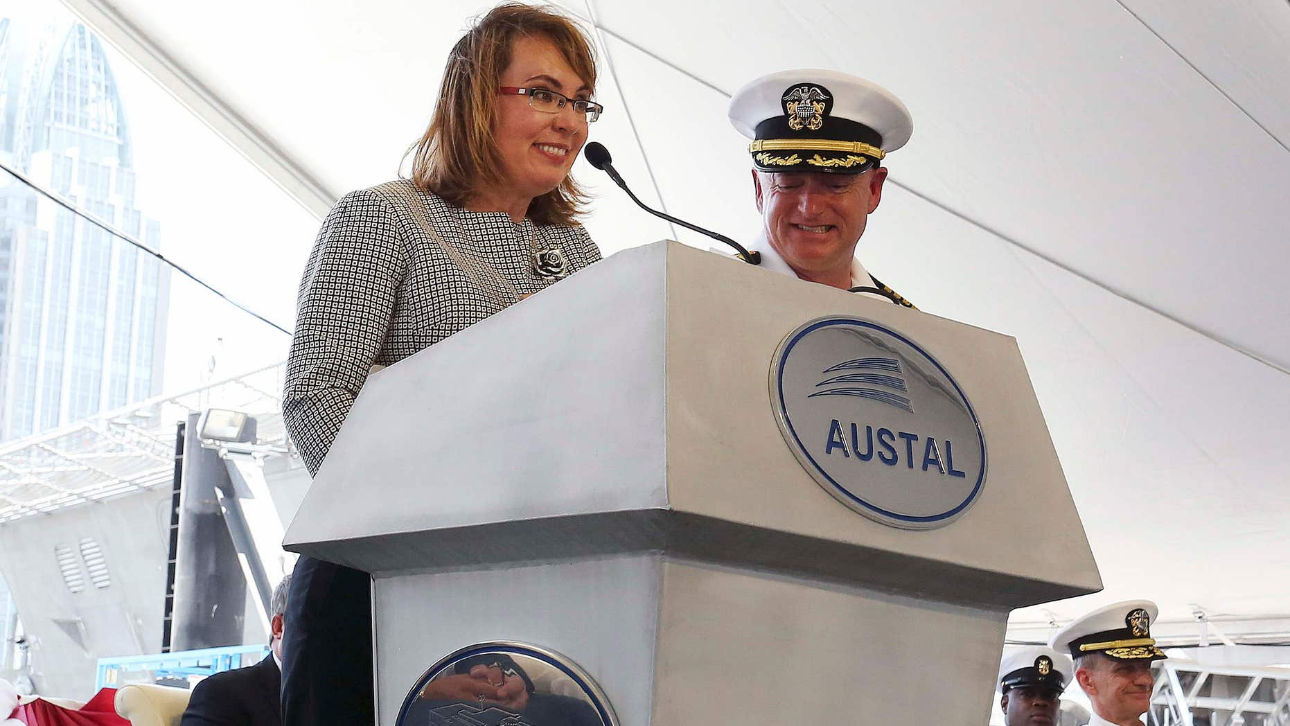 June 13, 2015: Former U.S. Rep. Gabrielle Giffords of Arizona delivers remarks with her husband, retired U.S. Navy Capt. Mark Kelly, by her side as the USS Gabrielle Giffords, a littoral combat ship built at the Austal USA shipyards is christened during a ceremony.
