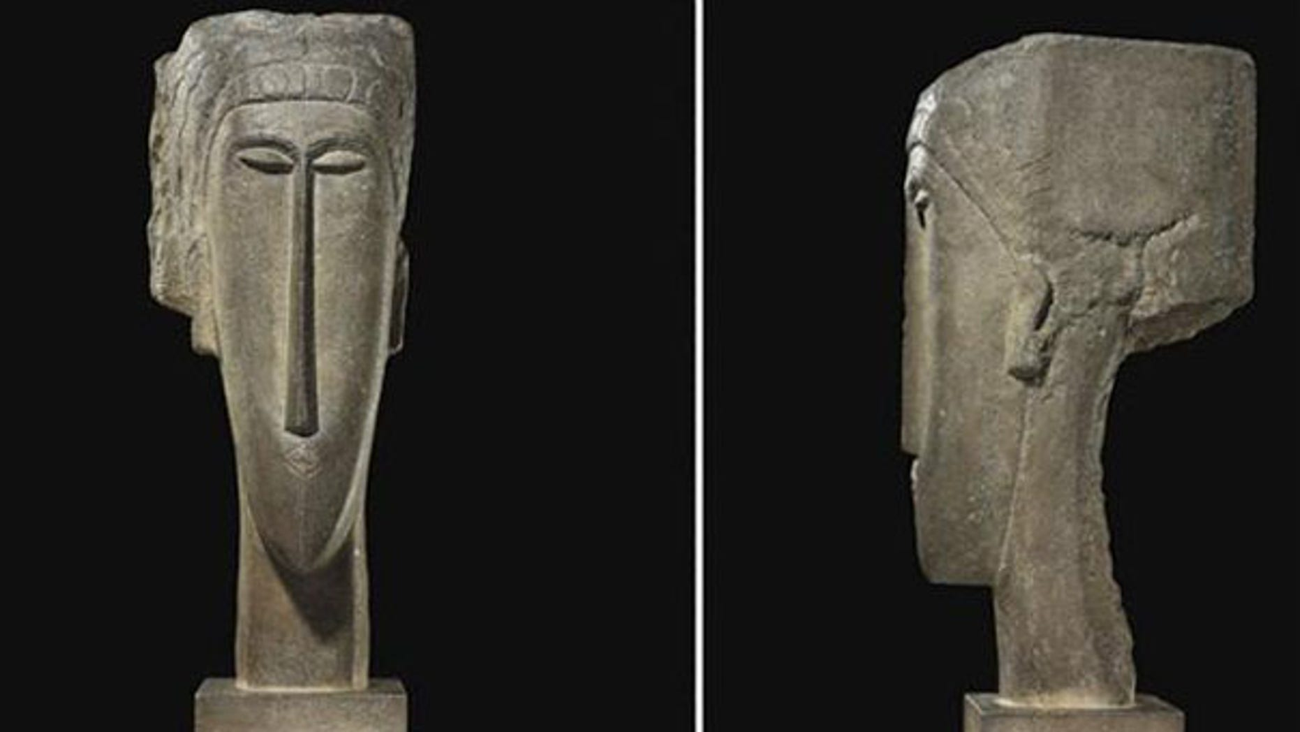 The stone sculpture 'Tete' by artist Amedeo Modigliani has sold for a record $52.8 million at auction in Paris.