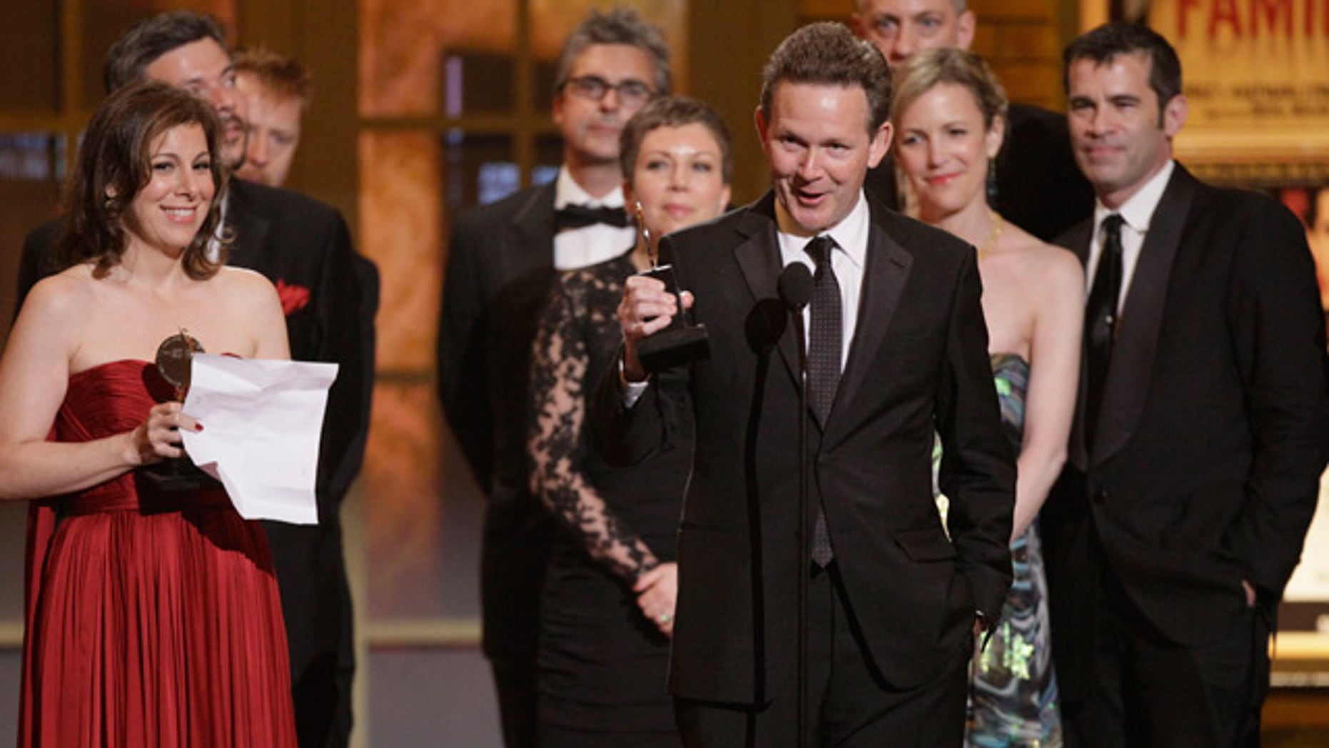 "June 13: Author John Logan accepts the Tony Award for Best Play for ""Red"" during the 61st Tony Awards in New York."